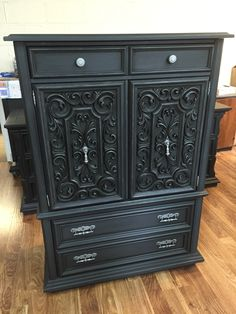 70's armoire in graphite chalk paint with a bit of metallic wax accent on the doors