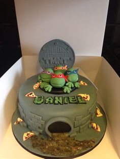Teenage Mutant Ninja Turtles (TMNT) Cake - coul be cute with green ooz coming out of the sewer. I like the pizza slices too. Ninja Turtle Birthday Cake, Ninja Turtle Cakes, Turtle Birthday Parties, Ninja Cake, 5th Birthday, Birthday Cakes, Birthday Ideas, Ninja Party, Ninja Turtle Party