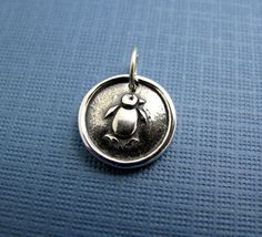 sterling silver penguin charm by Hint on Etsy, $36.00