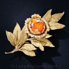 A one-of-a-kind work of wearable art by the inimitable Italian jewelry maestro - Buccellati. This fabulous and sizable floral brooch was created to showcase a magnificent gemological specimen that looks as though it came from another planet - a bright-ora Leaf Jewelry, Body Jewelry, Fine Jewelry, Natural Jewelry, Jewelry Box, Antique Jewelry, Vintage Jewelry, Golden Jewelry, Silver Jewelry