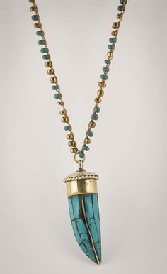 Crochet necklace with seed beads  and a turquoise horn. $45.00
