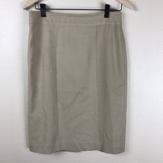 Gently used women's Banana Republic skirt in beautiful tan color - like a light camel color. Skirt has minor stains on the front and the stitching on the back slit is coming loose (see photos). | eBay!