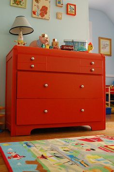 Red dresser with metal knobs