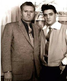 Elvis In the Army,in Germany,with his Dad, Vernon Presley.  Celebrating halfway point thru his service.