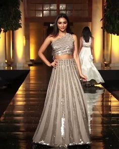Manish Malhotra Look 20 - Beautiful Embroidered Beige Two Piece One Shoulder A-Lane Evening Maxi Dress. Contemporary Art 2019 Runway Show Collection by Manish Malhotra Source by shivipin - Party Wear Indian Dresses, Indian Gowns Dresses, Dress Indian Style, Indian Wedding Outfits, Bridal Outfits, Indian Outfits, Indian Weddings, Dresses Dresses, Dance Dresses