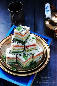 Three Layered Sandwich Dhokla cuisine Revive your flagging spirit any time of the day with these tasty and filling Sandwich Dhokla accompanied by a pot of good, strong Masala C… Veg Recipes, Indian Food Recipes, Cooking Recipes, Recipies, Yummy Recipes, Starter Recipes, Snack Recipes, Chickpea Recipes, Appetizer Recipes
