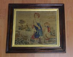 Antique needlework panel depicting 2 figures and a goat, 41.5cm x 46,5cm (frame)