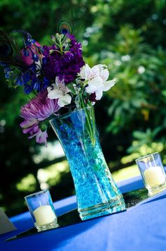 Blue and purple centerpieces... would look super cute with magenta flowers