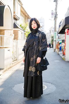 20-year-old Yoh's minimalist Harajuku street style with Kujaku top and Kujaku wide leg pants, a resale kimono jacket, Comme Des Garcons bag, and black boots.