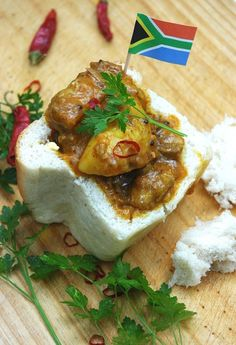 Have a taste of Durban with this Free Traditional South African Mutton Curry Bunny Chow. Bunny Chow is hollowed out bread filled with curry. South African Dishes, South African Recipes, Indian Food Recipes, South African Bunny Chow, Africa Recipes, Ethnic Recipes, Kos, Easy Cooking, Cooking Recipes