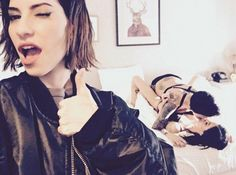 'Pervert': On Friday, Ruby Rose shared an Instagram photo of herself kissing girlfriend Jessica Origliasso in bed - featuring a guest appearance by Jessica's twin sister Lisa (L)