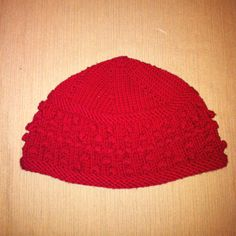 Knitted hat, pattern from Hip Knit Hats by Cathy Carron. Cool hat, but takes a LONG time to knit due to the fact that each 'bobble' is 8 stitches. Took me an entire winter to finish (a few years ago).Otherwise, not hard.