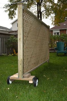 Decorative, movable privacy screen. Attach large planter box with climbing flowers.