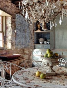 Charme de la campagne française <3. Love to combine rustic and rough with elegant crystal lighting