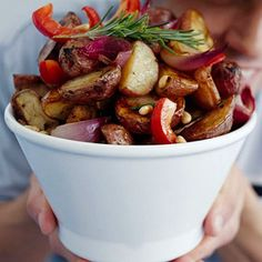 A savory blend of roasted new potatoes, red onion, sweet pepper, rosemary, and balsamic vinegar, topped with toasted pine, nuts revives basic potato salad. Serve it warm or chilled.