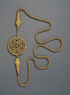 : This necklace is decorated with pseudo-filigree open work and beaten gold. Date 3rd century AD (Imperial) Medium gold