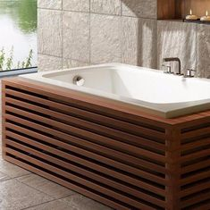 BainUltra manufacture therapeutic baths, care units and complementary products to improve relaxation, health and well-being Jacuzzi Bathtub, Bathtub Decor, Diy Bathtub, Bathtub Remodel, Whirlpool Bathtub, Bathroom Spa, Simple Bathroom, Corner Bathtub, Wooden Bath Panel