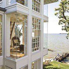 Love these windows in a house on the water.