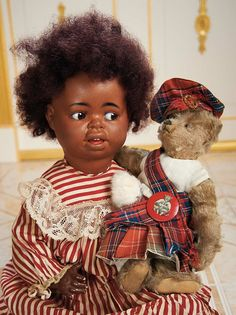 "Brown Scottish mohair bear, dressed in a Scottish outfit, with an antique doll. 10"" tall. Germany, c1915."