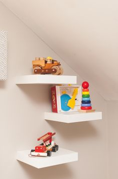These floating shelves featuring vintage, nostalgic toys are a fun accent in the nursery!