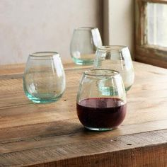 """FIRESIDE WINE TUMBLERS, SET OF 4 - Handblown of subtly green recycled glass, these generously curved wine tumblers help you celebrate the season in an eco-friendly way. Columbia. Dishwasher safe. Set of 4. Each 8 oz., 4-3/4""""H."""