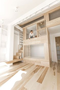 View in gallery Gorgeous loft apartment manages to incorporate a space-conscious playroom