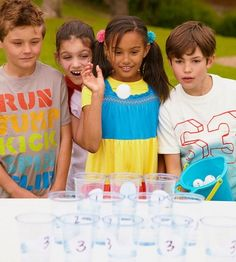 Set plastic party cups half-filled with water in three to five rows. Label the cups for scoring, with cups placed closest to the kids worth one point, and those farther away worth more. Set out a bucket of Ping- Pong balls.                 To mix it up a bit, buy a few blue or green balls or color some with markers. Award double points for a green ball landed in a cup and triple points for a blue. Each player gets 30 seconds to throw as many balls as possible into the cups. The player…