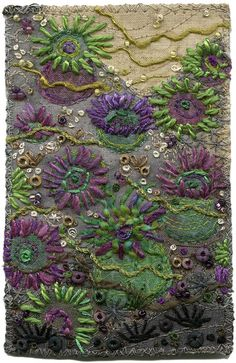 Sea Anemones  Tidepool exploration. The sea anemone tentacles are made with straight stitches and some couched threads. Beads and French knots represent limpets and small rocks and shells.  This is my impression of the green and purple anemones (aggregate anemones) scattered about the coast of BC, Canada. Marine life provides a huge wealth of inspiration for the textile artist.