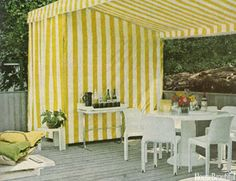 Guess the Year: A Striped Yellow Cabana  - HouseBeautiful.com