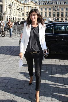 Emmanuelle Alt has dressed the same way for years but still always manages to look interesting. Sometime around 2008, she stopped wearing skirts and dresses entirely, instead adopting a uniform of fitted pants (often skinny-fit and cuffed), collared button-down shirts, and blazers. During colder months, she opts for a sensible black puffy jacket or wool peacoat; when it comes to shoes, she'll often wear a strappy heel or ankle boot. Her chic, confident simplicity is a great palette-cleanser.