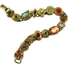 http://www.rubylane.com/item/707413-GOLD13/Vintage-Unsigned-Goldette-Charm-Slide-Bracelet