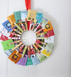 """""""This tea wreath displays all sipping options for guests. To make, cut a cardboard ring 12 inches in diameter, and cover with pretty paper. Then glue down 16 to 24 clothespins (I decorated mine with paper) for pinning the bags."""" –Kirstin Gentry of Kojodesigns Courtesy of Kirstin Gentry - Redbook.com"""