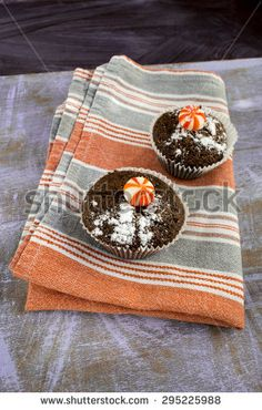 Fresh muffins with bonbons - stock photo
