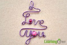 Add beads to the love letters for the DIY personalized necklace