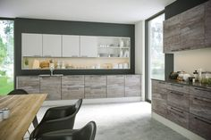 The two-tone combination of our Driftwood Light Grey and Supermatt Light Grey doors bring a natural touch to your new bespoke kitchen. As the dramatic timber textures fuse with the simple, calming grey tones you create a relaxing living space. Home Design, Driftwood Kitchen, Best Hacks, Light Grey Kitchens, High Gloss Kitchen, Home Improvement Companies, Colorful Interior Design, Grey Doors, Kitchens And Bedrooms