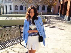 Peplum dress (worn as a skirt) with a structured floral print top and light blue coat from Zara