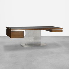 Lot 313: Warren Platner. executive desk. c. 1965, stainless steel, walnut, leather, aluminum. 84 w x 40 d x 30½ h in. result: $10,240. estimate: $10,000–15,000. Desk features two drawers. Signed with applied manufacturer's label to drawer: [Lehigh-Leopold Designed by Warren Platner]. Provenance: Burlington Northern Railroad, Saint Paul, MN | Private Collection, Saint Paul, MN
