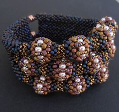 Guinevere bracelet by Cielo Design, via Flickr. love, love, love everything about this bracelet!