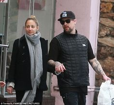 So in love:Nicole was the picture of contentment as she smiled while leaving the store, with her husband by her side