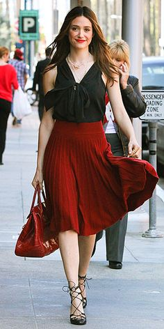 """Emmy Rossum is all kinds of classy in this summer ensemble.... love the classic red/black combo, the pleated skirt is very """"now"""", and the bow tie blouse is too cute.... also love the funky sandals, just the right touch to de-prep this outfit!"""