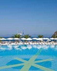 Hillside Beach Club  ( Fethiye, Turkey )  The main swimming pool (there are three) has stunning views across the Mediterranean Sea. #Jetsetter