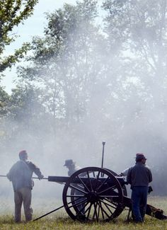 Cannon smoke hung in the air at Pawnee City Historical Days with Civil War Reenactments in Pawnee, City, Neb., on Sept. 16, 2004. The men were reenacting the Battle of Perryville, which took place in 1862. LAURA INNS/THE WORLD-HERALD