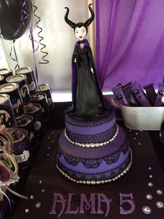 Amazing cake at a Maleficent birthday party!  See more party planning ideas at CatchMyParty.com!