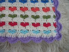 I Love Scraps pattern free on Ravelry. Afghan has a shell border iso fringe.   #free #crochet #pattern