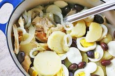 Portuguese Salt Cod Stew (Bacalhoada) ~ Traditional bacalhau recipe, a Portuguese salt cod stew made with salt cod, potatoes, onions, hard boiled eggs, olives, and lots of olive oil. ~ SimplyRecipes.com