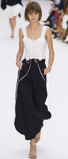 Shop now. Chloé Tapered Trousers. A polished way to tap into the new season's military vibes, these wide-legged, fluid black trousers are accented with utilitarian details such as the statement stitching across the front and D-ring waistband straps. Buttoned cuff straps can be adjusted to create a more tapered silhouette. Concealed zip and press stud fastening at the front.