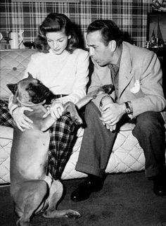 Humphrey Bogart and Lauren Bacall with their pet boxer at home, circa 1945.