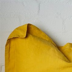 Your bed linen should add to the look and feel of your bedroom, go bold and add colour with this yellow linen #ILOVETHATSTYLE
