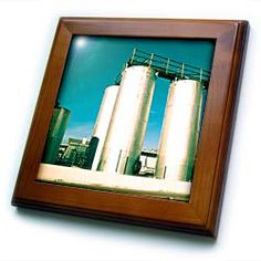 A green tinted silo in Mesquite, Nevada near the street Framed Tile