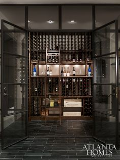 The wine cellar was treated to meticulous detailing, from steel-framed windows to moody tile.